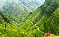 Pass road hugs the mountain plateau of Van, Ha Giang, Vietnam royalty free stock image