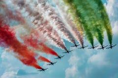 Pass with smokes in color of the Italian flag aerobatic team. Pass with smokes in color of the Italian flag 313. Gruppo Addestramento Acrobatico, Pattuglia Stock Photos