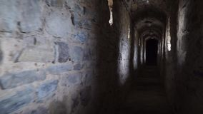 Pass under the ancient tunnel stretching into perspective stock footage