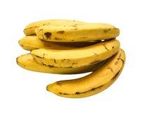 Passados bananas amarelas em um fundo branco Foto de Stock Royalty Free