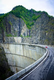 Passage. An old dam with mountains in the background Royalty Free Stock Photos