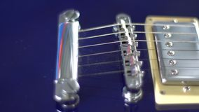 Passage along the strings on an electric guitar close-up stock video
