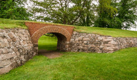 Passage through the archway at Fort Anne Park, Halifax, Nova Scotia. Historical site of yesteryear, a brick archway supports an overpassing route, formerly used Stock Image