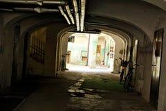 Passage with bicycles in Ljubljana. Dark passage with bicycles in Ljubljana, Slovenia Royalty Free Stock Image
