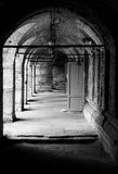 Passage with brick walls and doors royalty free stock image