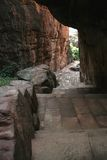 Passage through Cave. Passage with dressed stone tiles under rocky roof, Badami, Karnataka, India, Asia Stock Image