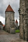Passage in the city defense wall of Tallinn. On the roofs of the towers red tile. royalty free stock photo