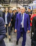Passage of the delegation to the exposition hall. Participants and visitors of the annual St. Petersburg Gas Forum Royalty Free Stock Photography