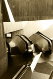 Passage with escalators, sepia hue Royalty Free Stock Photography