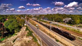 Passage of historic steam locomotive in Wawer in Poland. Aerial photo of historic train in Miedzeszyn in Warsaw. Ty-42-107 Steam engine from Chabówka open air stock photo