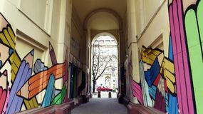 Passage in Historical Building with Drawing of Colorful Pencils royalty free stock photo