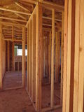 Passage inside a wooden house under construction. Inside view of a portion of an incomplete wooden house stock images