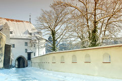Passage and loopholes in before the castle in Alte. Walls with loopholes and historical plaster street and a fool passage with snow Stock Photography
