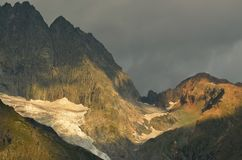 Passage in mountains. This is passage about red summit in Caucasus mountains Royalty Free Stock Photography
