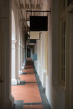 Passage in old classical building. With shops' signboards Stock Images