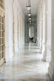 Passage in old classical building. With lamps ans doors Stock Photo