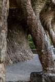 Passage with pillars vertical. Passage with pillars at park Güell in Barcelona with vegetation vertical stock photography