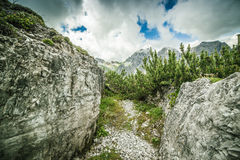 Passage between the rocks in the mountains Royalty Free Stock Image