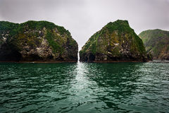 Passage between rocky cliffs that form the coastline of the Avacha Bay. Kamchatka, Russia Royalty Free Stock Image