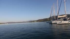 Passage of the sailing vessel along the coast of Poros island, Aegean Sea. stock footage