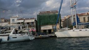 Passage of sailing vessel along the coast of Poros island, Aegean Sea stock footage