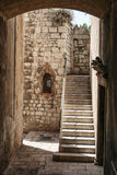 Passage with stairs. Old town passage with stairs and small wall shrine in historic center of Sibenik, Croatian Stock Photo