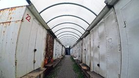 The passage between the stalls of metal. Background bright light sky city stock video footage