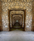 Passage through the stone walls. Passage through the ancient stone walls royalty free stock images