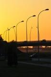 Passage supérieur de coucher du soleil image stock