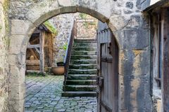Passage to courtyard in medieval city Honfleur in Normandy, France Royalty Free Stock Photo