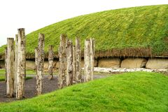 Neolithic wooden timber henge. The passage tomb at Newgrange served as a focus of ceremonial activity in the Late Neolithic and Bronze Age. A complex of royalty free stock photo