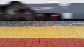 Passage of the train in the station. At daytime. Shot with a Canon 5D Mark II stock footage