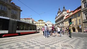 A tram on the street in Prague. The passage of a tram in the streets of the historic center of Prague, Czech Republic stock video
