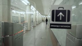 Passage through the turnstile in the metro from the first person. stock video footage