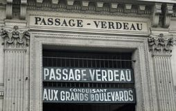 Sign for Passage Verdeau, Paris France. The passage Verdeau is a Paris covered walkway located in the 9th arrondissement . Arcade full of shops. This is the sign Royalty Free Stock Photos
