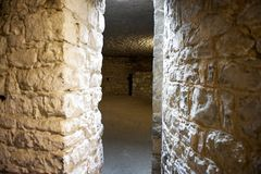 Passage Way Between Rooms in a Castle. A narrow stone passage between empty rooms in a castle. Horizontal shot Royalty Free Stock Photography
