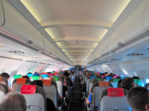 Passageiros, cabine e assentos do avião Fotografia de Stock