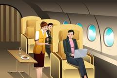 Passageiros da primeira classe que estão sendo servidos pelo aeromoço ilustração do vetor