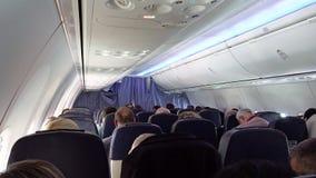 Passageiros em assentos do jato dos aviões do avião Fotografia de Stock Royalty Free