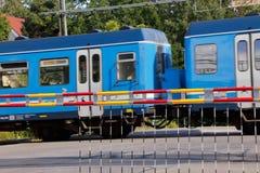 Passagem de nível com trem Imagens de Stock