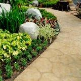 Passagem de pedra no jardim Imagens de Stock Royalty Free