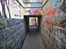 Passagem subterrânea com grafittis Foto de Stock Royalty Free