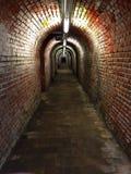 Passagem subterrânea na construção velha Imagens de Stock Royalty Free