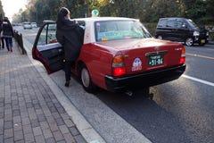 Passager consigue en un taxi en Kyot Imagen de archivo libre de regalías
