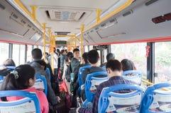 Passagerare i bussen Arkivbild