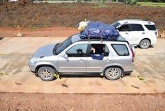 Passagerare till och med denfärdiga avgiftvägen Royaltyfri Foto