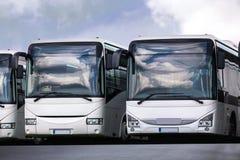 Passageraren bussar i rad arkivbilder