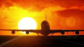 Passagerareniv?n landar under en underbar soluppg?ng arkivfilmer