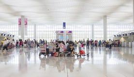 Passagers dans Hong Kong International Airport photo stock