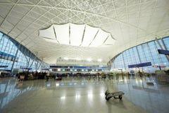 Passagers dans l'aéroport de Guangzhou (Baiyun) Images libres de droits